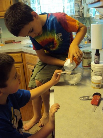 Riley and Caden making toothpaste