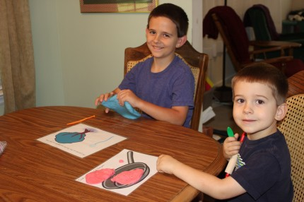 JJ and Riley with frying pan playdough mat