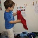 Josiah sorting laundry by color